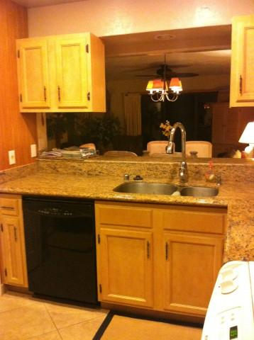 kitchen has granite & tile